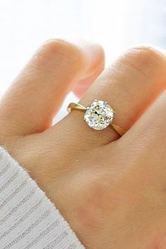 Antique Cushion Cut Engagement Ring, platinum prongs with a yellow gold band