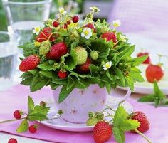 Arrangements for a strawberry themed wedding- favours could be strawberry boxes including little jars mason jars of whipped cream and homemade biscuits.  :D
