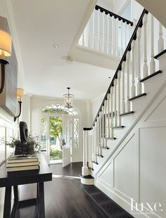 White Dutch Colonial Revival Entry - Luxe Interiors + Design