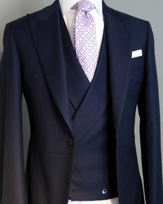 Awesome take on the double-breasted waistcoat. Sleek. This looks dashing!