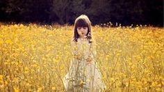 Child in a Flower Field