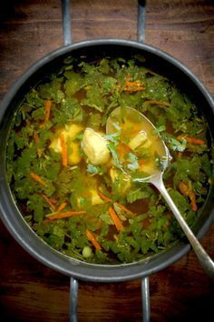 Immune boosting Chicken-Soup with ginger, turmeric, 10 garlic, chicken stock and meat, coriander stem Ad leaves, any added vegies like thin clicked capsicum, red cabbage, carrot,   Snow pea, eggs poured in to make noodles if desired.