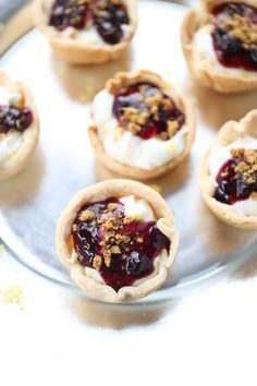 These mini pies are filled with a creamy lemon flavored filling and topped with a simple blueberry topping!