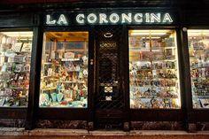La Coroncina è il più antico negozio di Bologna. E' infatti dal lontano 1694 che i bolognesi affidano barba e capelli ai prodotti che si possono trovare in questo locale, in origine nato come negozio di articoli religiosi gestito dai frati Cappuccini.  L'arredo è ancora quello di inizio '900 e l'atmosfera è quella di un bazar dove, oltre ai prodotti per barba e capelli, si possono trovare anche articoli da regalo, da gioco e per fumatori.