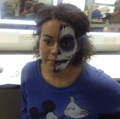 The amazing demonstration of sugar skull face painting my teacher did on me.