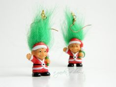 These are a fun pair of Russ© Merry little trolls™ Santas earrings with green synthetic hair! These are in good condition and sure to bring some