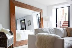 10 Easy Projects to Improve Your Rental Apartment - Hang mirrors to make a space feel bigger.