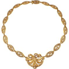 French 18k yellow gold seed pearl necklace. The necklace is centered by a large yellow gold leaf, suspended by open work links decorated with seed