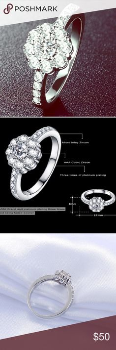 Beautiful Engagement Platinum Plated CZ Halo Ring COMING SOON!!!Absolutely STUNNING, this beautiful triple platinum plated and high quality AAA cubic zirconia micro inlay halo style engagement ring 💍 is the perfect piece to say yes to.  Size 7. From Anfansi Jewelers, Italy. Color ME Crazy Boutique Jewelry Rings