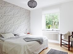 Stylish Bedroom Design with Wooden Floor and White Wall Paint and Tree Branches Wallpaper
