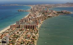 "La Manga del Mar Menor (meaning ""The Sandbar of the Minor Sea"") is a seaside spit in the Region of Murcia, Spain. Costa, Cartagena Spain, Spanish Towns, New Spain, World View, Spain Travel, People Around The World, Beautiful Landscapes, Good Times"