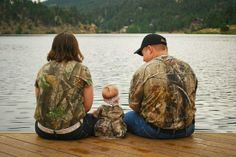 Family picture dress in camo, sitting by the lake