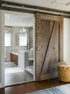 Barn door leading to modern bathroom