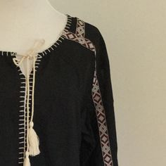 Freeway Black Boho Peasant Blouse Black blouse with red and white details. Tie neck with tassel closure, dropped sleeves with venting at the bottom. Never worn. Beautiful stitching details. Freeway Tops Blouses