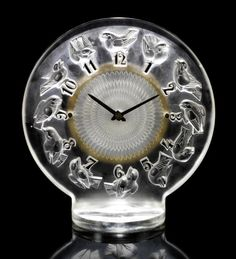 René Lalique  'Rossignols' a Clock, design 1931  frosted glass, with black enamel numerals, Omega movement  20.5cm high, etched 'R. Lalique France'