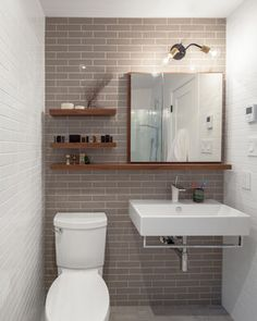 downstairs bathroom shelves and full mirror Degrassi - contemporary - Bathroom - Toronto - Wanda Ely Architect Inc.