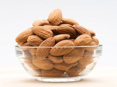 A handful of almonds with a glass of water is a great energy booster. Keep a bag of raw unsalted almonds in the car or at your desk for a non-caffeine pick-me-up.