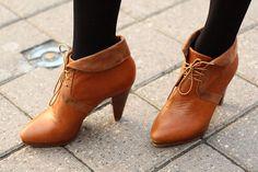 Orange leather, black tights.