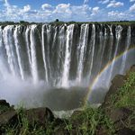The Victoria Falls is a waterfall located in southern Africa on the Zambezi River between the countries of Zambia and Zimbabwe. Seven Natural Wonders of the World by CNN. Famous Waterfalls, Beautiful Waterfalls, Places To Travel, Places To See, Travel Destinations, Africa Destinations, Chutes Victoria, 7 Natural Wonders, What A Wonderful World