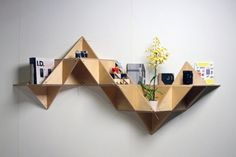 T.SHELF (Triangular shelf) is a modular system that can be built into multiple shapes with various functions.  Using the strongest geometric shape, the triangle, the T.SHELF system creates structures that develop into sculptural pieces.