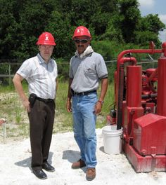 Terry Aylward and Nasser Amiry, P.E. of Griffin Dewatering on a jobsite next to a Griffin #Wellpoint Pump.