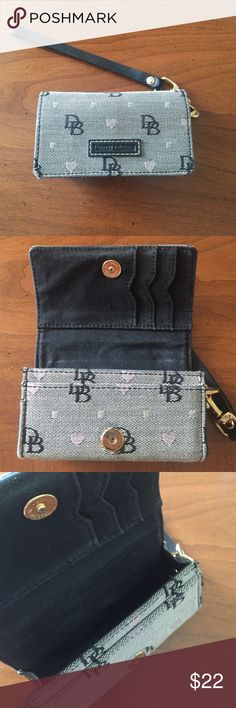 """Dooney and Bourke camera case I bought this as a camera case for a small camera! Super cute and it almost looks like a coin purse. You could use it as a coin purse as well! It is still in very good condition! It is 5""""x 3"""" Dooney & Bourke Bags Clutches & Wristlets"""