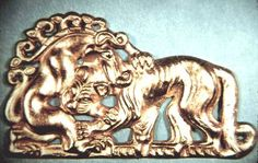 (Sarmatian gold plaque of fight between a lion and a griffin, western Siberia)