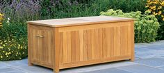 Teak Storage Box- Our roomy storage box will allow you to keep a number of large cushions outside without bringing them indoors. The top of the box is silicon sealed, while the bottom is slatted so cushions stay dry. #OutdoorStorage #Hauser