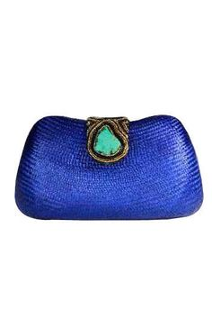 Embellished woven clutch made from buntal fiber (extracted from leaf stalks of Buri palm tree) and finished with a beautiful semi-precious turquoise stone, glass bead ornament, and finest rice beads! www.toniandberne.com