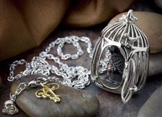 White metal simple birdcage necklace with horn bird