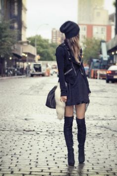 Black over the knee boots, leather jacket or 3/4 pea coat, black slouchy hat