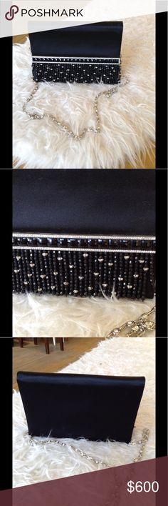 Valentino black silk handbag Valentino black silk & beaded handbag with crystal chain strap. Valentino Bags Clutches & Wristlets