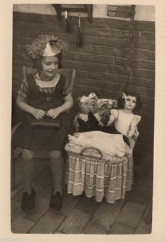 Vintage photo little girl in granny costume with doll teddy bear