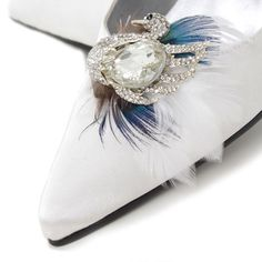 Flawless Grace Shoe Clips Get the Wow Factor!. Stunning crystal swan with diamante wings surrounded by stunning white and peacock feathers,  simply clip them on the front, side or back of shoes.   Price £24.95