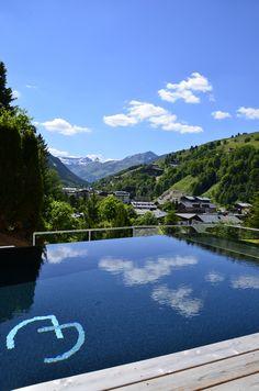 Alpin Juwel   Lifestyle Hotel   Saalbach Hinterglemm   Austria   http://lifestylehotels.net/en/alpin-juwel   Panorama infinity pool with a wonderful view on the alps that surround the hotel.
