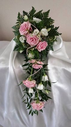 This is a beautiful bridal shower using pinks and white flowers with various foliage.