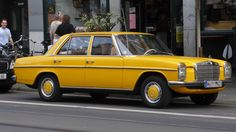 Another gorgeous Mercedes-Benz that I stopped cycling across Cologne Germany to take a photo of...couldn't resist of course.  This is a1976 Mercedes-Benz 300d.  An amazing car!  Such a striking colour of yellow.