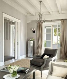 neutral color palette, white ceiling, elegant furnishings, beige curtains, grey walls and beautiful natural light. Living Room Windows, Living Room Colors, Living Room Grey, Home Living Room, Living Room Decor, Grey Room, Dining Room, Lounge Design, Curtains For Grey Walls