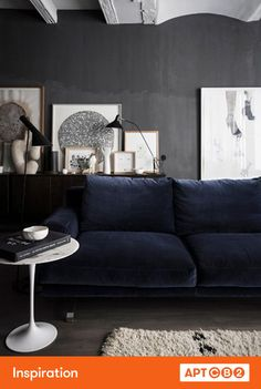 Navy is a rich and saturated hue – this room amps up the sophistication with lux velvet upholstery.  The union of the graphite walls and black & white art elevates and enhances the entire room. #APTCB2 #workswithcb2