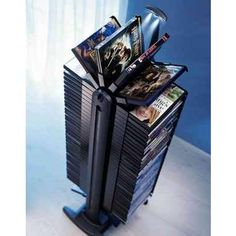 DVD Power Tower 80 Motorized Organizer for DVD Storage: Those of us who have endless amounts of time on our hands love to watch movies! But sometimes the collection can get out of hand! This DVD Power Tower stores and flips through all your movies in one fell swoop so you don't have to! This is a lot nicer gift for your film enthusiast than the usual DVD rack!