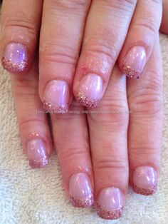 Acrylic sculptured nails with pink glitter French tips