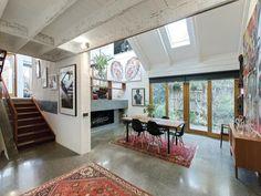 LOVE the concrete floors.  Contemporary split-level Australian family house