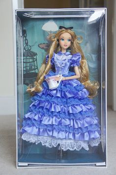 Disney Limited Edition Alice in Wonderland Doll does anyone have one of these dolls they can do a trade for