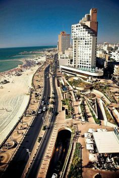 Tel Aviv beaches and that Promenade/Boardwalk! Some restaurants are open 24/7 and serve you directly on the beach in the sand. Tel-Aviv, Israel.