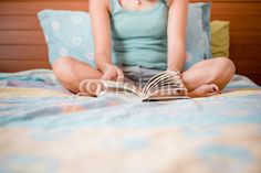 beautiful woman reading in bed from $1