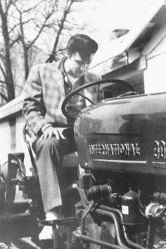On April 15, 1957, the day the Presleys had hoped to move into Graceland, they were still living in the house on Audubon. Contractors still had a month's work ahead of them. On that day, however, Elvis, now back in town after completing his spring tour, visited Graceland and posed for photographers on a tractor he had purchased for use on the property.http://www.elvis-history-blog.com/graceland.html