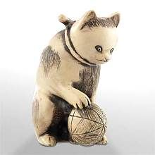"Cat with Ball - Japanese Netsuke : The Japanese cat is unique with his bobbed tail. This charming cat playfully rests its paw on a ball and wears a special collar indicating he is loved.  LOT 615 : 1"" xc .62"" x 1.375"""