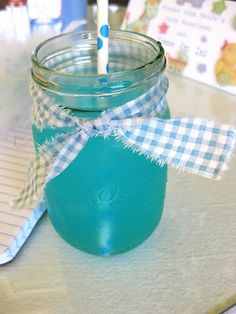 Its a boy baby shower blue punch in mason jars adorned with gingham bows and sweet blue and white straws...sweeeeet!