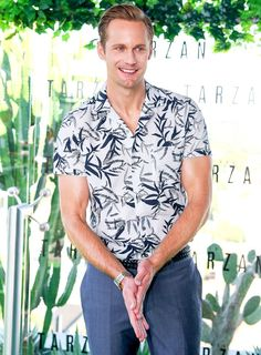 Alexander Skarsgard channeled Tarzan with a jungle print shirt while promoting the film. See other celeb pics!