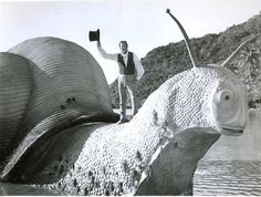 """Dr. Doolittle sailing home on a Giant Pink Sea-Snail. Photo still from """"Doctor Doolittle"""" (1967) starring Rex Harrison."""